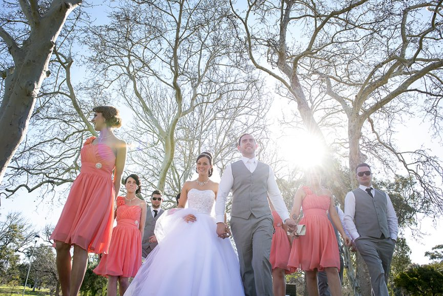 pretty romantic beautiful photography Adelaide photographer trees park peach dresses grey suits vest  black white tie strapless Australia headband veil sequins white gold silver earrings necklace