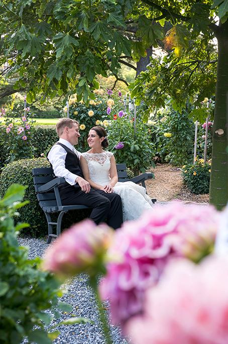 bride wedding flowers beautiful groom happy newlyweds photography trees Adelaide Botanic Gardens suit lace dress hair up-do pink yellow photographers