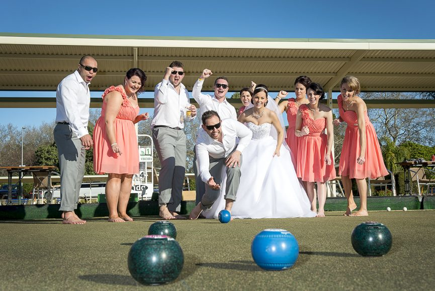 lawn bowls Adelaide happy Australia fun dresses peach bridesmaids wedding photography strapless dress groomsmen grey suit pants slacks white gold silver shirt accessories headband necklace jewelry earrings