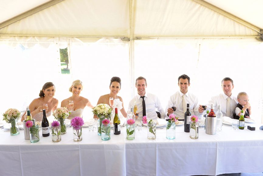 cheers reception wedding pink flowers white roses bouquet happy bridal party beer red wine bridesmaids silver sequins accessories table setting groomsmen Paige-boy Adelaide photography bride groom South Australia photographer