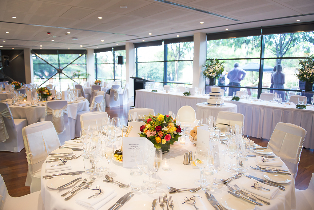 beautiful flowers wedding reception cake colorful red pink yellow table setting Adelaide Wine Centre  photographer South Australia