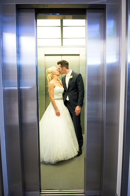 wedding day, love, wine centre, Adelaide, South Australia, lift, elevator, happy, romantic, Italian, newlyweds, photographer, photography, dress, silver, accessories, white gold, suit, tie, blue