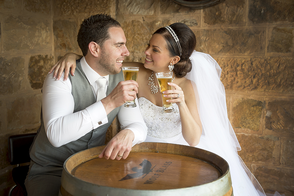 cheers Italian newlyweds relaxing pint beer Adelaide wedding reception Australia photography Sferas Convention Centre Sfera happy grey suit vest white tie strapless dress sequins veil silver white gold accessories headband earrings necklace photography photographer