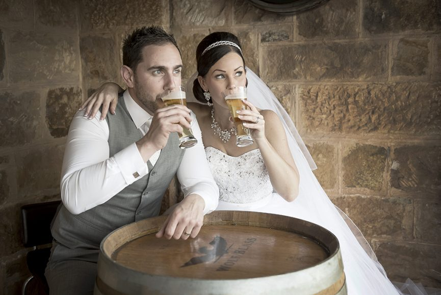 photographer wedding Adelaide Australia photography happy newlyweds Italian pint beer relaxing Sferas Convention Centre happy Sfera white strapless dress sequins grey suit vest veil white gold silver accessories necklace earrings headband  bride groom