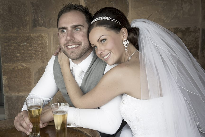 wedding Sferas Convention Centre Sfera photography newlyweds Italian Adelaide Australia photographer happy bride groom pint beer grey suit vest strapless dress sequins silver white gold accessories earrings makeup necklace headband