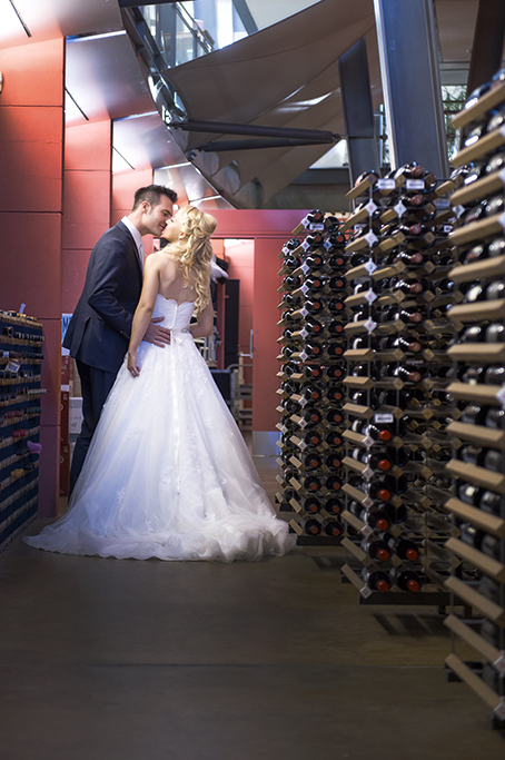 Wine Centre, Adelaide, cellar, happy, romantic, Italian, newlyweds, wedding, kiss, dress, white, blue suit, silver, white gold, bride, groom, photography, photographer, South Australia