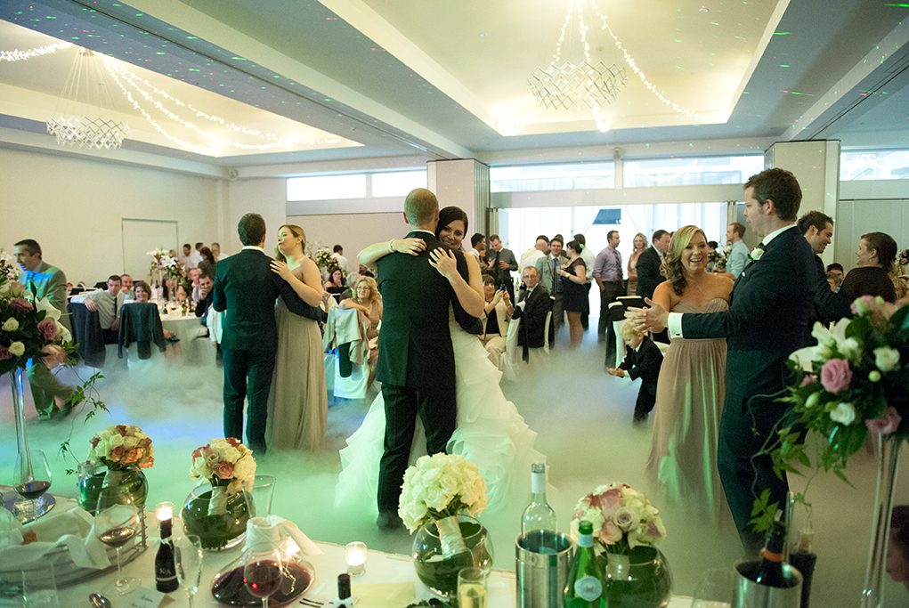 Sferas Convention Centre wedding reception dry ice beautiful candles red wine flowers roses white pastel pink bouquets light fittings love happy newlyweds bride groom bridal party dancing neon lights guests photography South Australia photographer