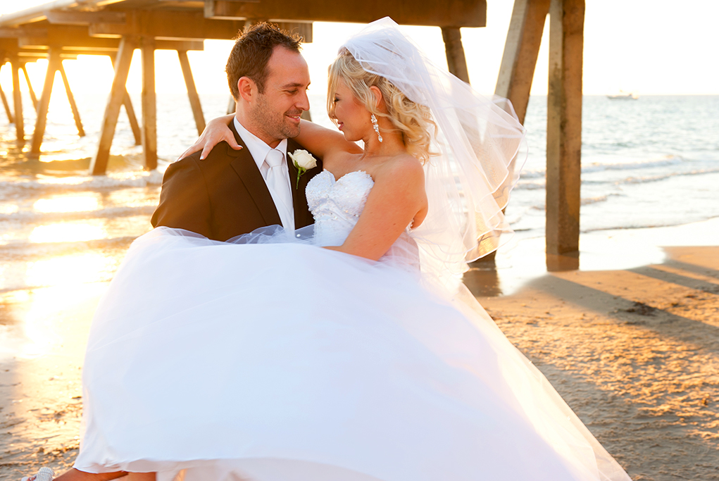 love, newlyweds, beautiful, romantic, beach, Henley, evening, sunset, sand, Australia, ocean, boat, warm, jetty, wedding, cute, rose, white, tie, vest, suit, Adelaide, black, dress, beading, embellished, photographer, strapless, veil, earrings, acrylic nails, photography, silver, white gold, curls, hair, up-do