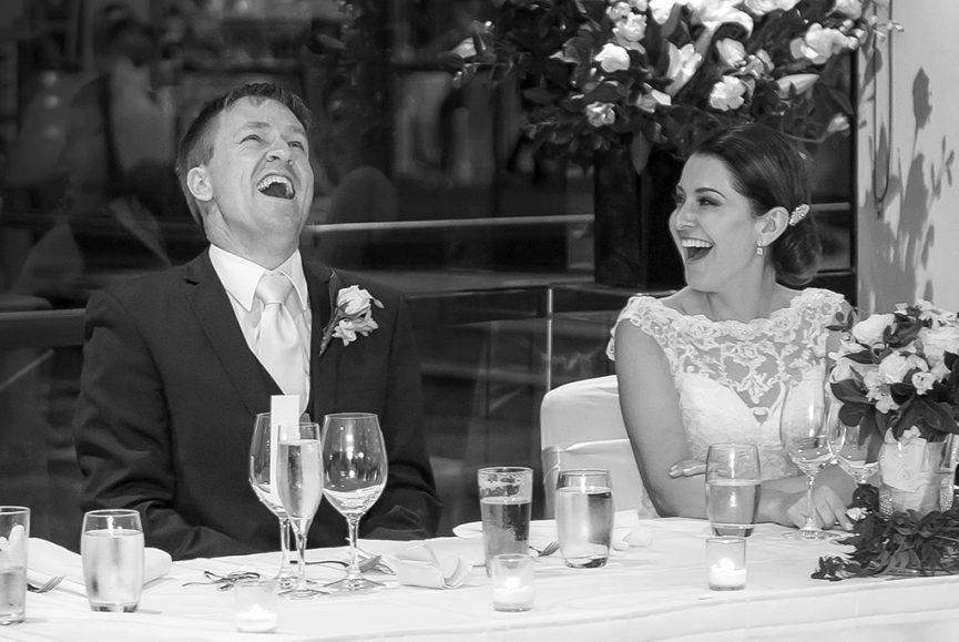 happy laughter groom suit flowers roses bride newlyweds reception lace dress Adelaide South Australia wedding photography black and white glasses photographer