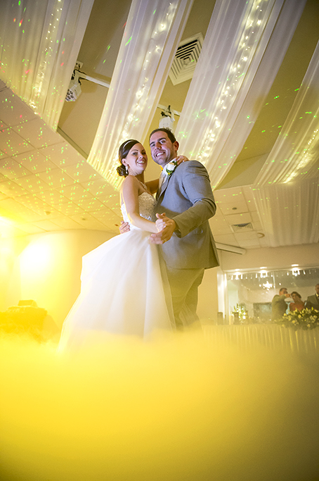 reception Sferas Convention Centre Sfera Adelaide Australia yellow dry ice newlyweds bride groom first dance neon lights strapless dress sequins silver white gold headband photography necklace earrings grey suit rose photographer