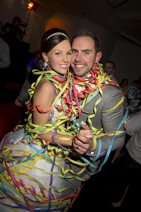 Sferas Convention Centre reception Sfera bride groom happy first dance streamers colorful Adelaide Australia grey suit strapless dress white gold silver accessories headband earrings photographer photography