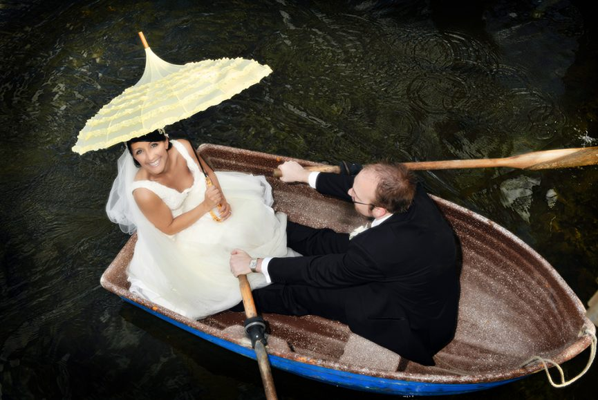River Torrens, Adelaide, city, row boat, paddles, happy, romantic, photography, water, aerial, photographer, pretty, beautiful, bride, love, groom, suit, tie, rose, umbrella, yellow, blue, veil, dress, smile, wedding, Australia, city