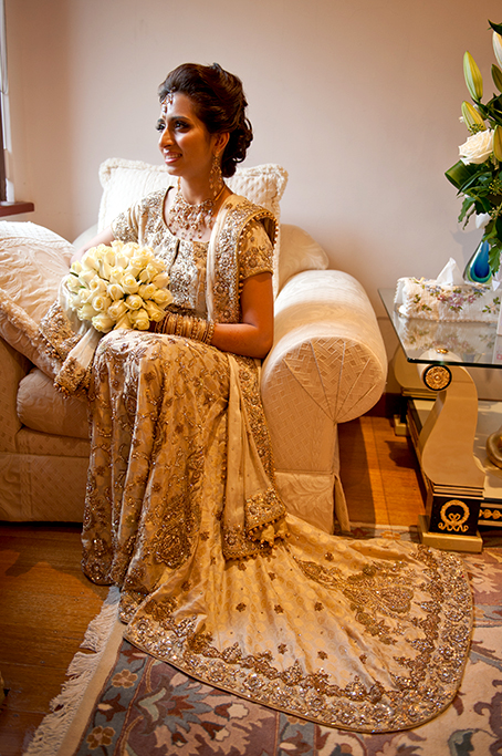 beautiful, bride, happy, stunning, embellished, dress, gown, attire, gold, sequins, bangles, couch, chair, cushions, white, roses, necklace, earrings, bangles, headpiece, South Australia, photography, Adelaide, Indian, photographer, traditional, wedding