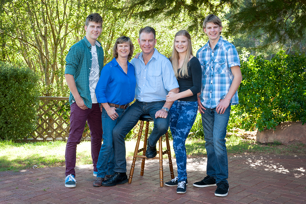 family, outdoor, portrait, happy, kids, parents, nature, trees, location, photography, photographer, relaxed, casual, denim jeans, shirt, blue, green, black, stool, Adelaide, South Australia