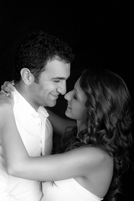balck and white fun romantic studio portrait of young couple