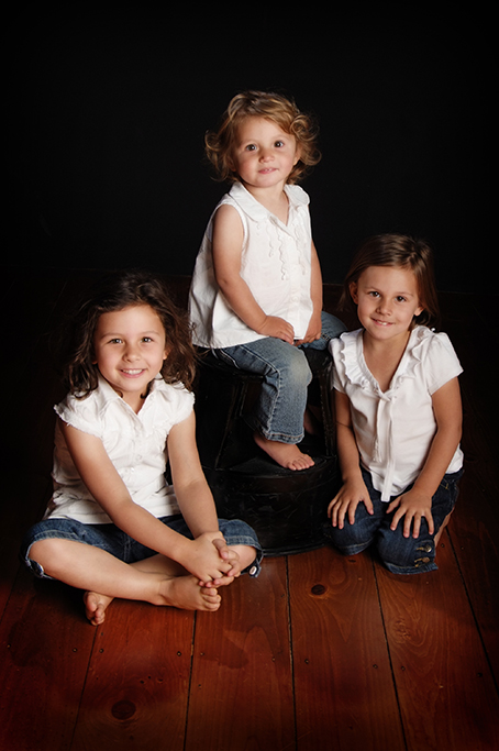 girls, sisters, siblings, cute, happy, smiles, white t-shirt, denim jeans, shorts, kids, Adelaide, studio, South Australia, photographer, photography, timber, wooden floorboards
