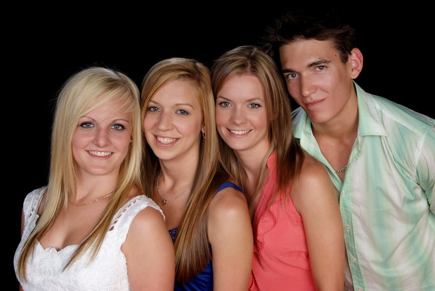 brother and 3 sisters smart casual clothing on black back ground