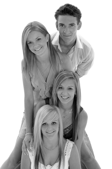 black and white brother and 3 sisters casual clothing on white back ground as present for mum and dad