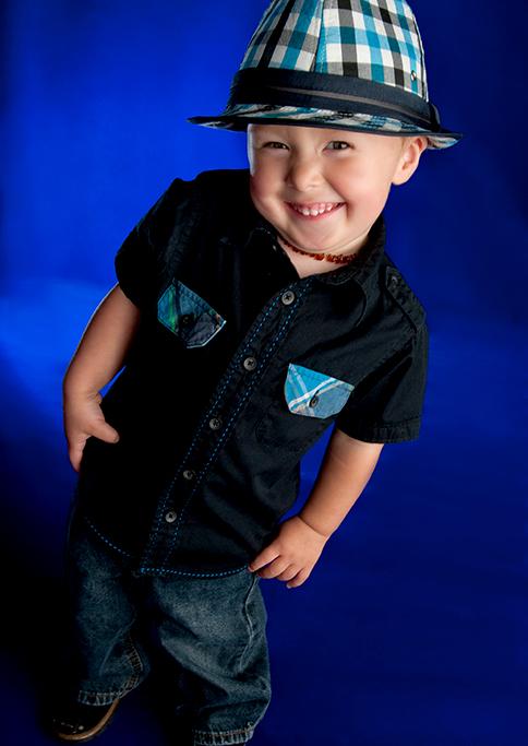 blue, checkers hat, black shirt, jeans, blue background, studio, happy, kids, children, boy, Adelaide, South Australia, photography, photographer, studio session, happy, fun, smile