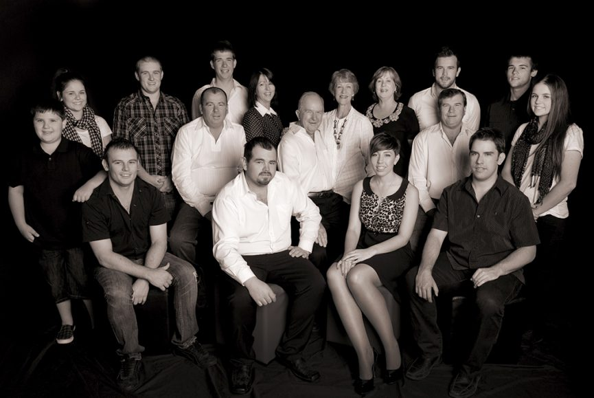 large family group of 17 people generational relaxed black and white studio family portrait
