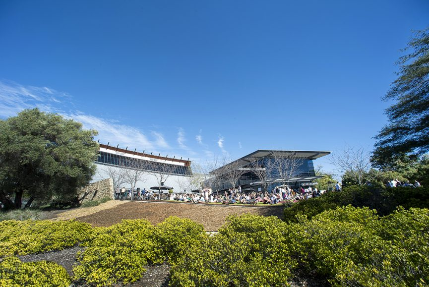 chef, catering, restaurant, Adelaide, staff, South Australia, corporate location photography, Outside image of the wine centre with garden and sky view as backdrop to the buildings curved lines, National Wine Centre Adelaide, photographer, group photo, warm sunny day, winter wine festival at the National Wine Centre