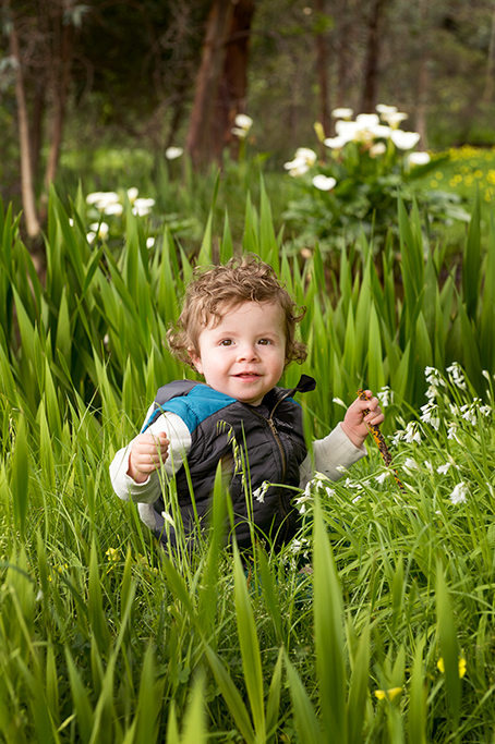 white flowers, grass, park, nature, happy, baby, child, casual, relaxed, location, photography, Adelaide, photographer, South Australia, vest, boy