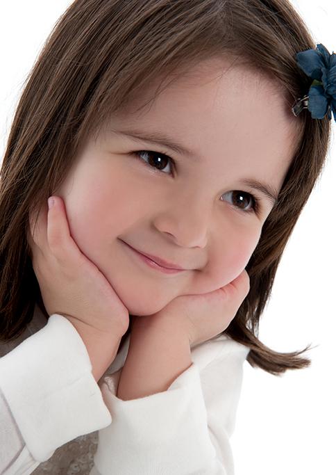 blue flower clip, white top, background, studio, happy, kids, children, girl, photography, Adelaide, South Australia, smiles