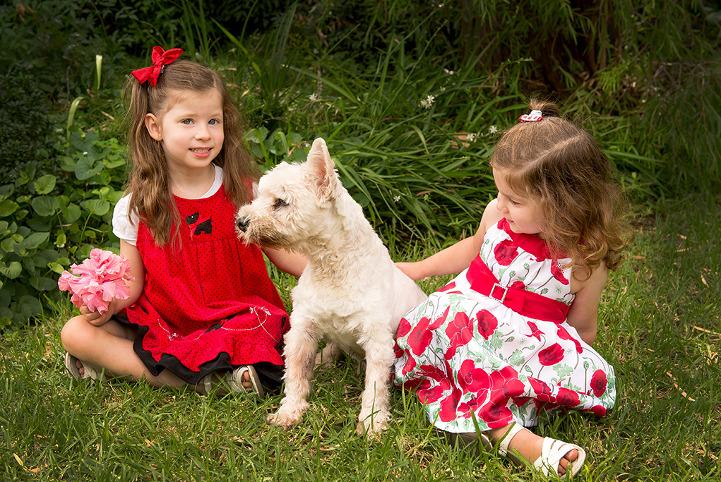 white fluffy dog, cute photography, photographer, Adelaide, pink, flower, kids, children, red dress, flowers, bow, location, nature