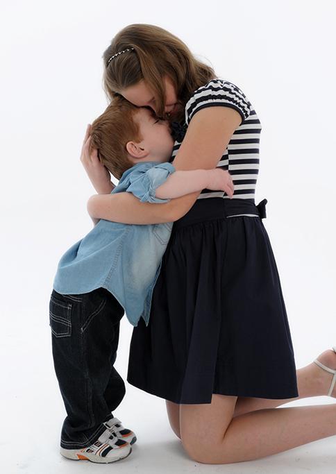 hug, brother sister, siblings, happy, family, photography, studio, white background, photographer, Adelaide, South Australia, love, denim, black and white stripe top dress, headband