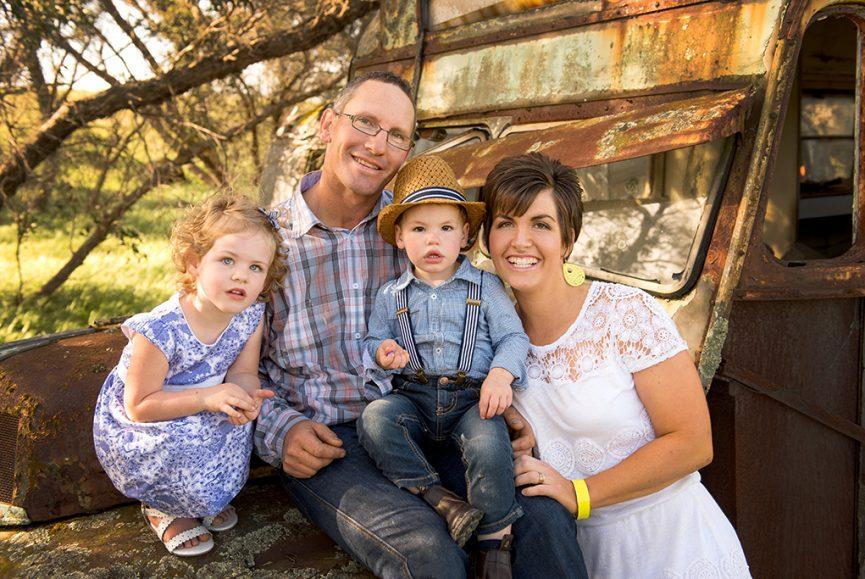 location, family portrait, cute, countryside, kids, children, mum, dad, parents, photography, photographer, rustic, truck, floral dress, lace, suspenders, denim jeans, checkers shirt, hat