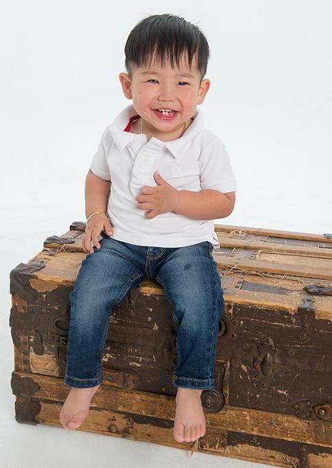 kids, studio, photography, Adelaide, South Australia, photographer, wood, timber chest, box, happy, smile, child, boy, white t-shirt, denim jeans