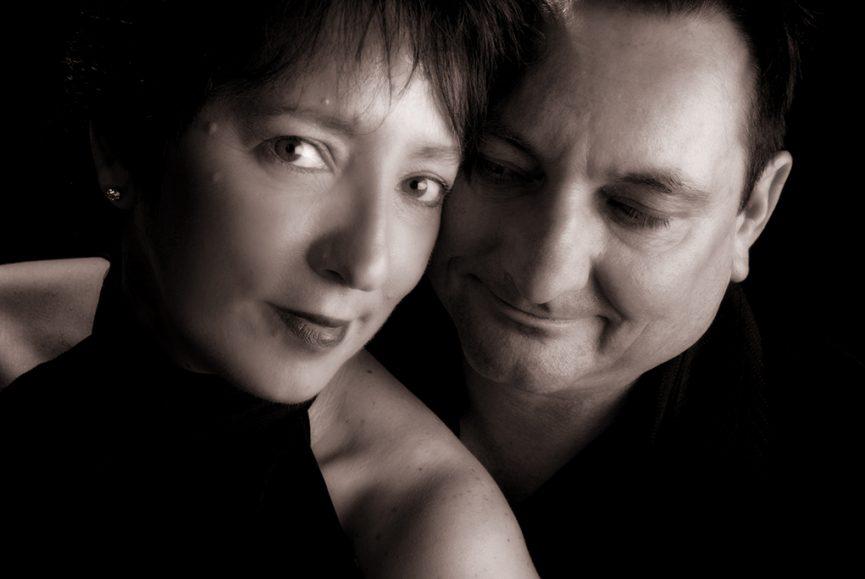 black and white romantic mood studio portrait of a couple