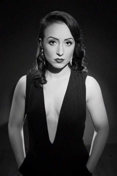 black and white classic hollywood style studio portrait of brunette lady dark background glamorous sultry sexy mood shot