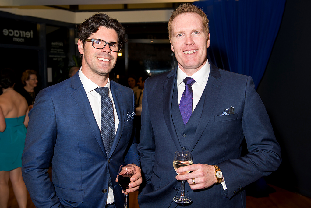 Corporate Cocktail event featuring 2 well dressed men in corporate attire enjoying pre event drinks and wine at the Crown Plaza Adelaide wine dinner featuring Bird in Hand Winery