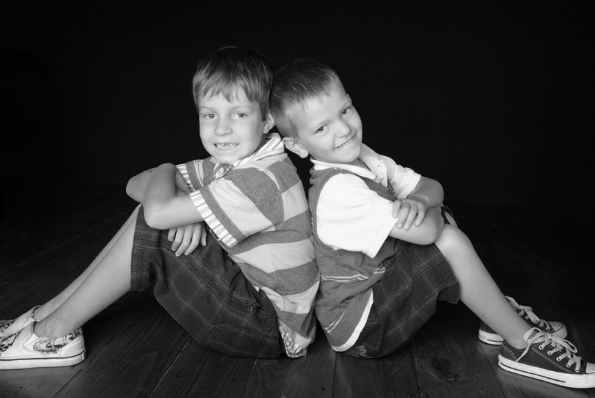 black and white photography, happy, kids, boys, brothers, studio, photographer, timber, floorboards, t-shirt, shorts, casual