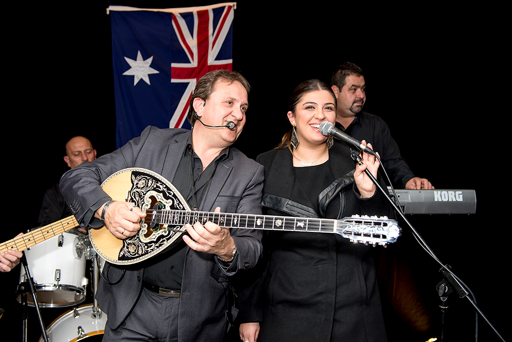Corporate event launch, image featuring Greek band, singers and bazouki