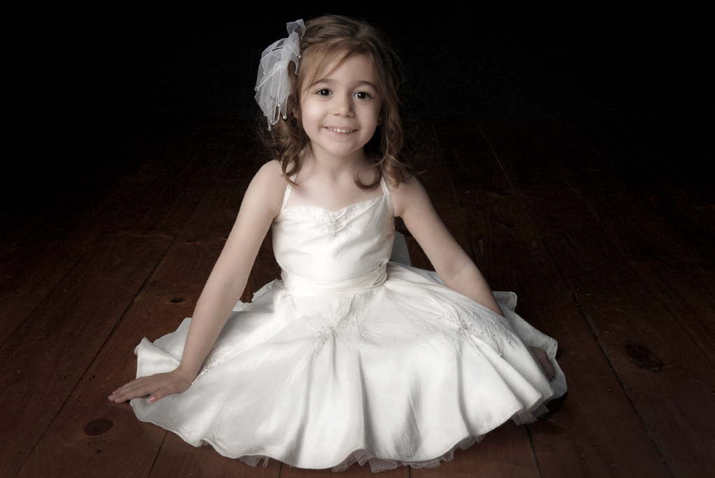 studio, happy, girl, kids, children, beautiful, Adelaide, photographer, photography, smile, white dress, beads, hair piece, timber, wood floorboards