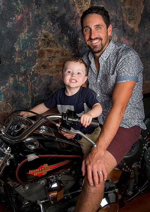 happy, smile, kids, children, dad, son, Harley Davidson, motorbike, t-shirt, shirt, shorts, studio, photography, South Australia, Adelaide, photographer