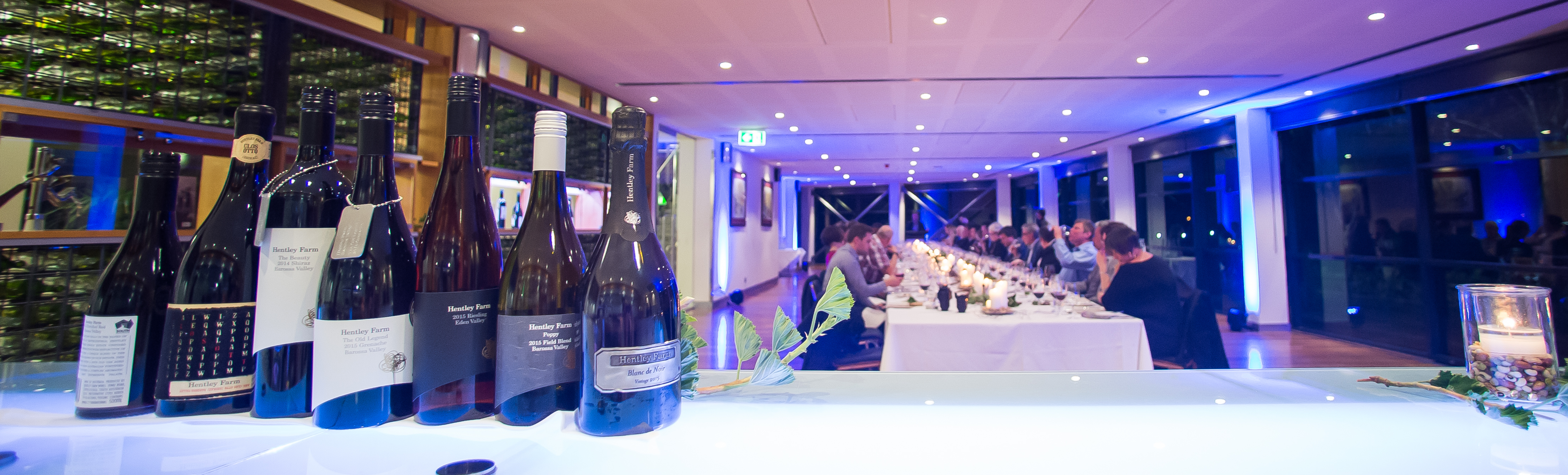 Wine image, wine bottles on a glass bar top, corporate dinner event, National wine centre