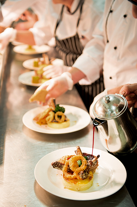 Food photography, image of several chefs doing final prep and presentation of food for a degaustaion dinner at the National Wine Centre