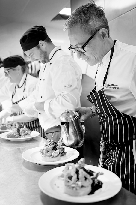Black and white image of 3 chefs plating up gourmet Meals, National Wine Centre, degaustation wine dinner, gourmet food photography, coporate image photography