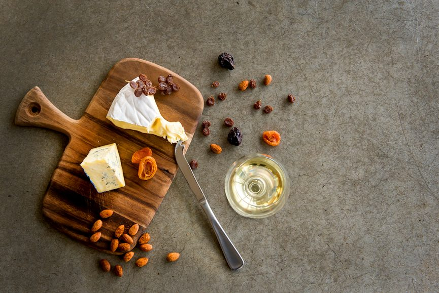 Food photography, cheese nuts and dried fruit with cheese knife arranged on a decorative curved timber cheese board, national wine centre of Australia, Adelaide south Australia