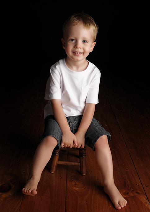 children, kids, boy, white t-shirt, denim shorts, happy, wooden stool, floorboards, smile, South Australia, photographer, photography, studio, Adelaide