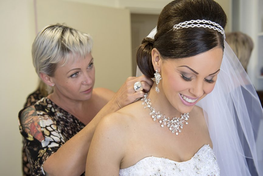 happy stunning beautiful gorgeous bride Italian wedding silver white gold headband accessories jewelry necklace earrings dress makeup getting ready Adelaide veil sequins photography Australia photographer