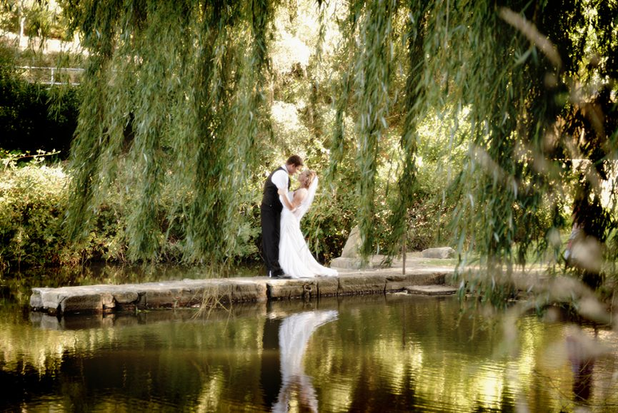 stunning, beautiful, nature, Glen Ewin Estate, Adelaide, photography, wedding, happy, photographer, bride, love, groom, vest, white, shirt, pants, dress, veil, embrace, rocks, lake, pond, trees, willow tree, bushes, Australia, reflection, water