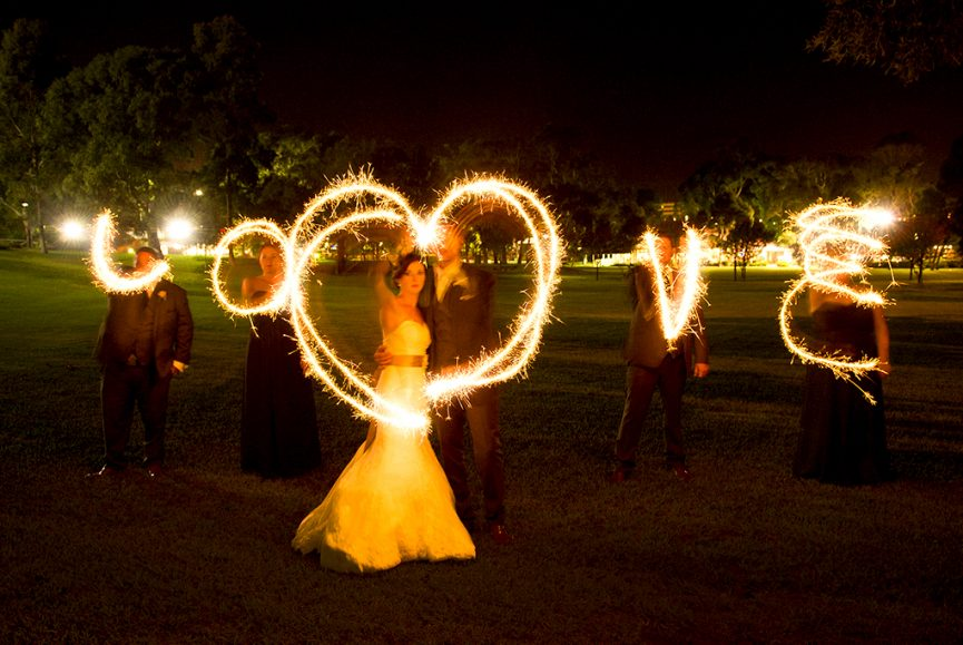 Love, sparklers, park, trees, night, photography, bridal party, groom, bridesmaids, groomsmen, bride, black, motion, grass, dress, suit, Australia, tie, pants, shoes, fishtail, wedding, letters, typography, writing, lights, ribbon, Adelaide