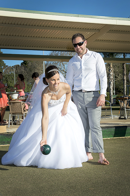 Italian wedding happy newlyweds fun photography Adelaide Australia lawn bowls grey pants slacks white shirt black sunglasses strapless dress sequins silver headband photographer white gold necklace earrings
