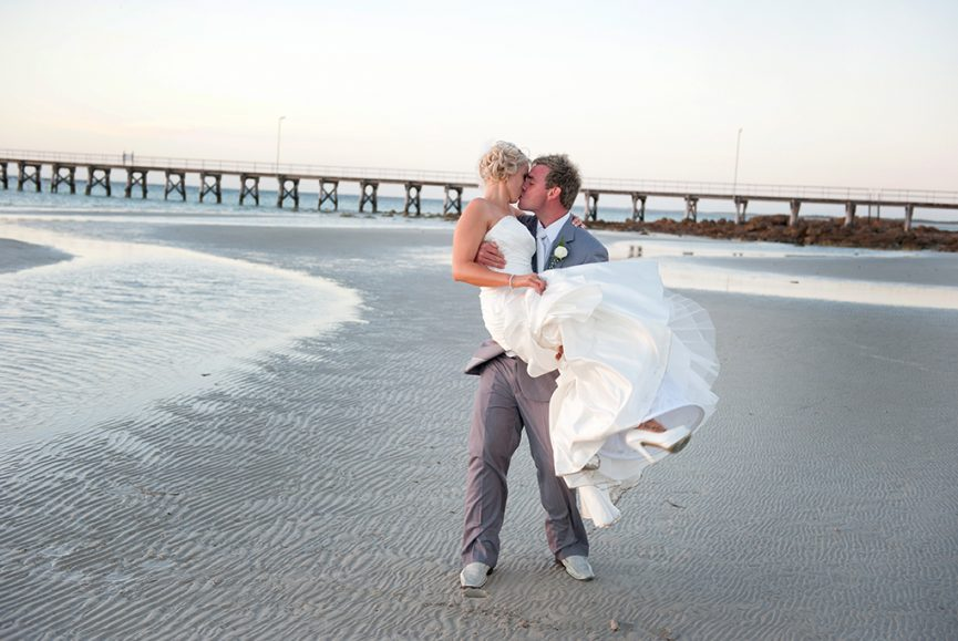 kiss wedding bride flowers shoes heels beach jetty ocean water sand groom grey suit dress Adelaide Port Lincoln photography