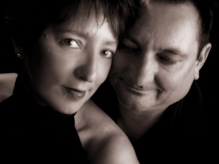 black and white romantic mood studio portrait of a couple